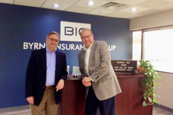 About Our Agency - Portrait of Byrne Insurance Group Agency Owners in the Office Reception Desk