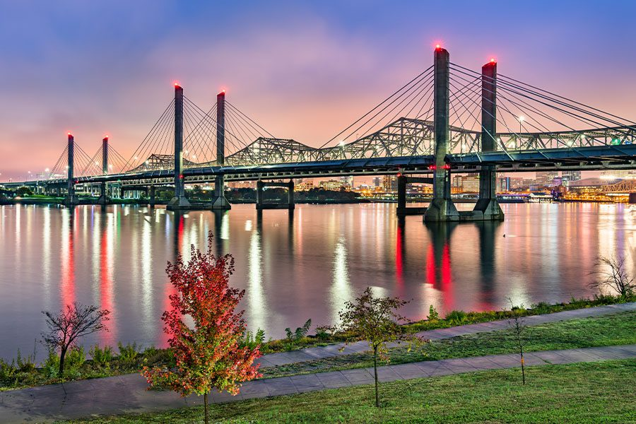 Contact - View of Bridge across the Ohio River between Louisville, Kentucky and Jeffersonville, Indiana at Dusk
