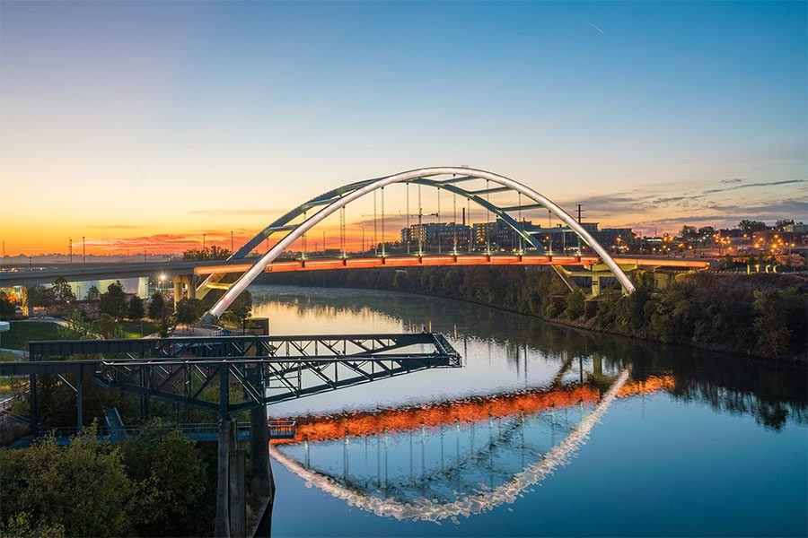 Contact - Scenic View of a Curved Bridge Across the River in Downtown Nashville Tennessee at Sunset