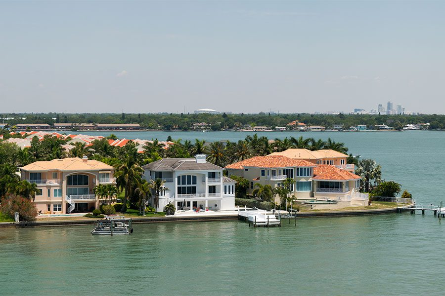 Personal Insurance - Scenic View of Luxury Waterfront Homes with Boat Ramps on a Sunny Day in Tampa Florida