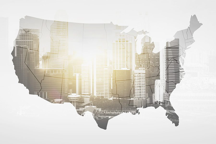 Homepage - Map of United States with a Grey City Commercial Building Overlay On Top