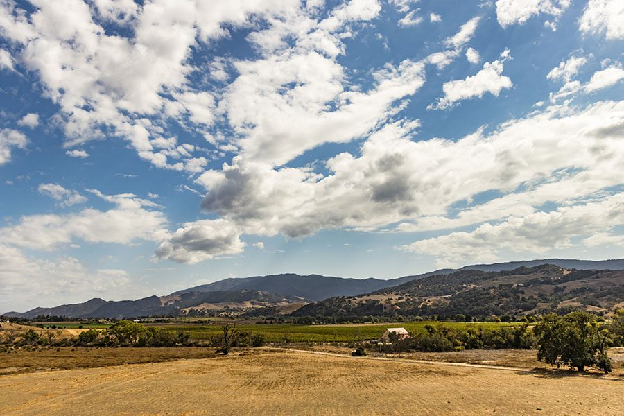 Orland CA - Scenic View of a Farm Landscape with Mountains in the Background in Orland California with a Cloudy Sky