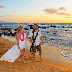 Shannon Weber - Bio Image - On Beach With Husband