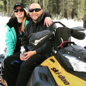 Shannon Weber - Bio Image - Snowmobiling With Husband