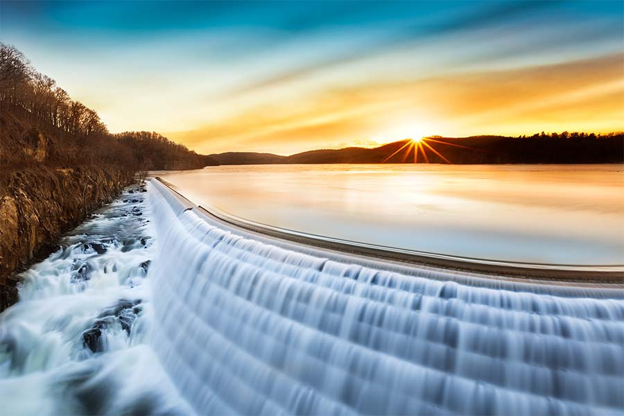 About Our Agency - Scenic View of the Croton Dam in Upstate New York During Sunrise with a Beautiful Colorful Sky