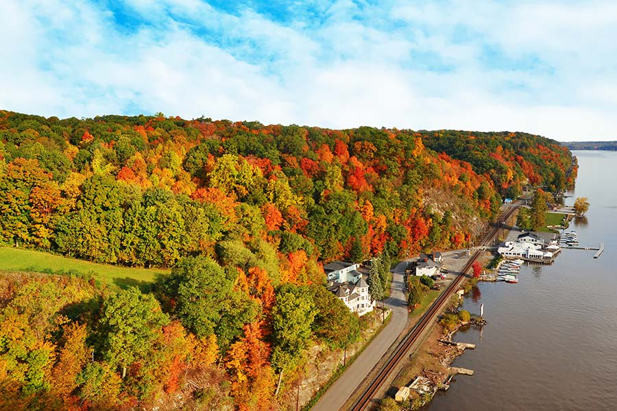 Mount Kisco NY - Scenic View of a Dock Along the Hudson River in Mount Kisco New York Surrounded by Colorful Fall Foliage