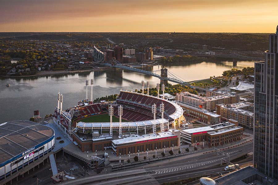 Contact - Aerial View of Downtown Cincinnati Ohio Next to the River at Sunset with Views of a Football Stadium and Buildings