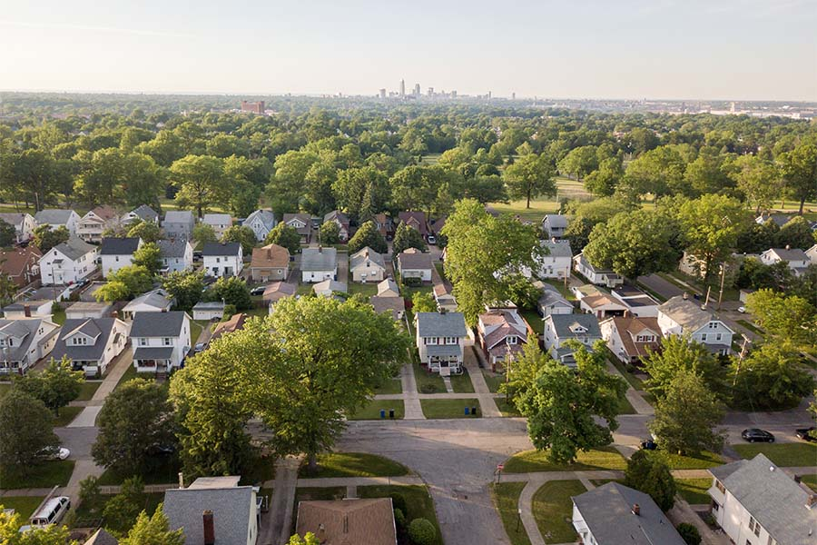 North Ridgeville, OH - Aerial View of Homes in a Quiet Neighborhood in the Suburbs of Cleveland Ohio with Views of Skyscrapers in the Background