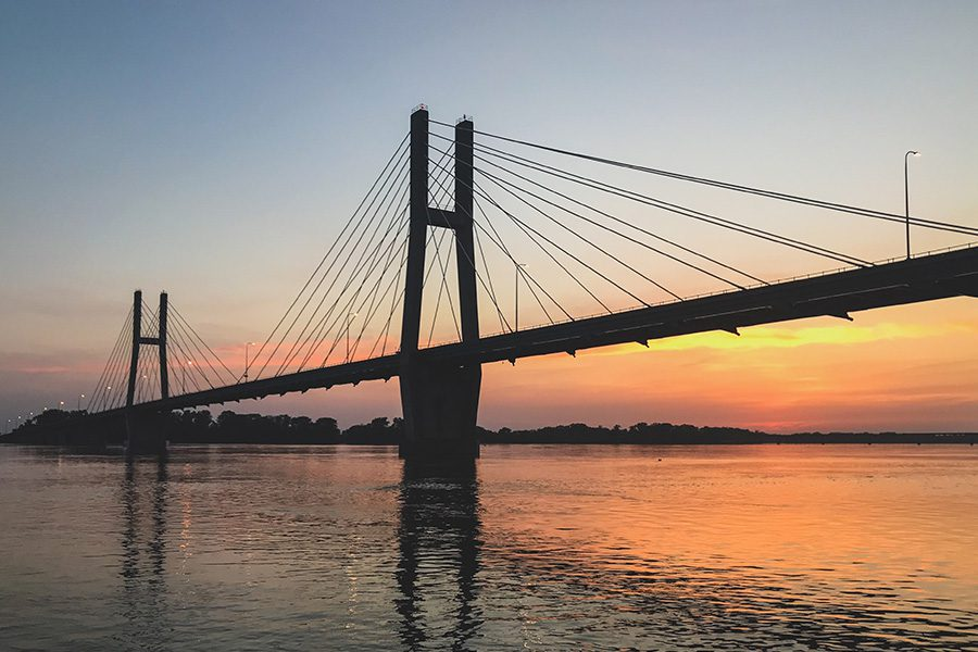Quincy, IL - Long Distance View of the Quincy Illinois Memorial Suspension Bridge at Sunset Over the Mississippi River