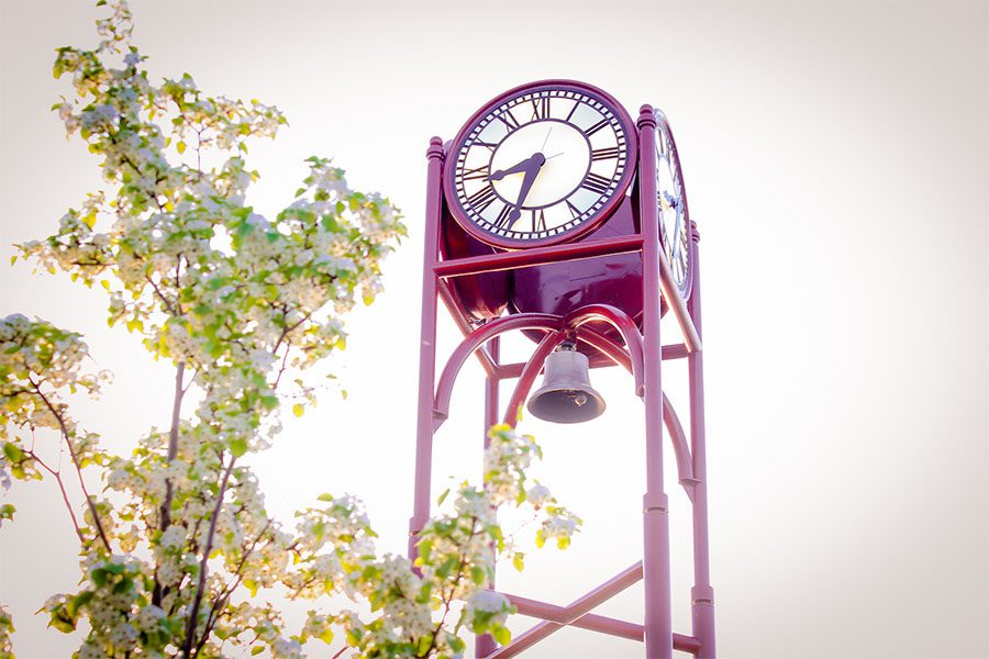 About Our Agency - Closeup View of the Petoskey Clock Tower on a Sunny Spring Day