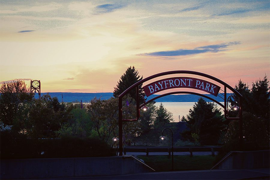 About Our Agency - View of Bayfront Park Front Sign in Petoskey Michigan at Sunset
