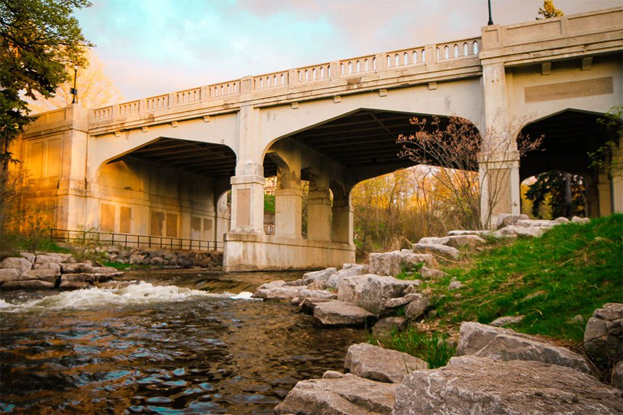 About Our Agency - View of a Bridge Across a River at Sunset in Petoskey Michigan