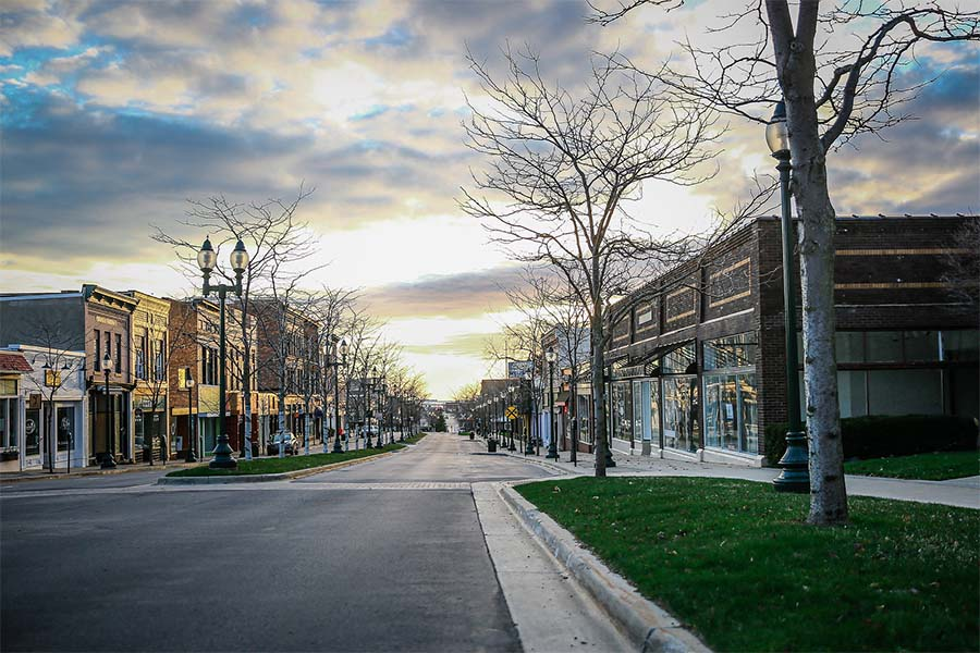 Business Insurance - View of Empty Main Street in Downtown Petoskey Michigan with Rows of Business Buildings on a Cloudy Winter Day
