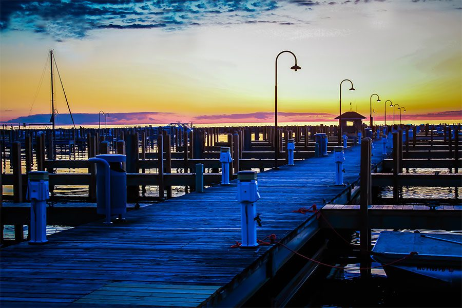 Client Center - Scenic View of a Marina on the Harbor in Petoskey Michigan with a Colorful Sunset Sky