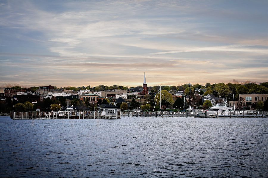 Contact - Scenic View of the Marina and Skyline of the City of Petoskey in Michigan on a Cloudy Day at Sunset
