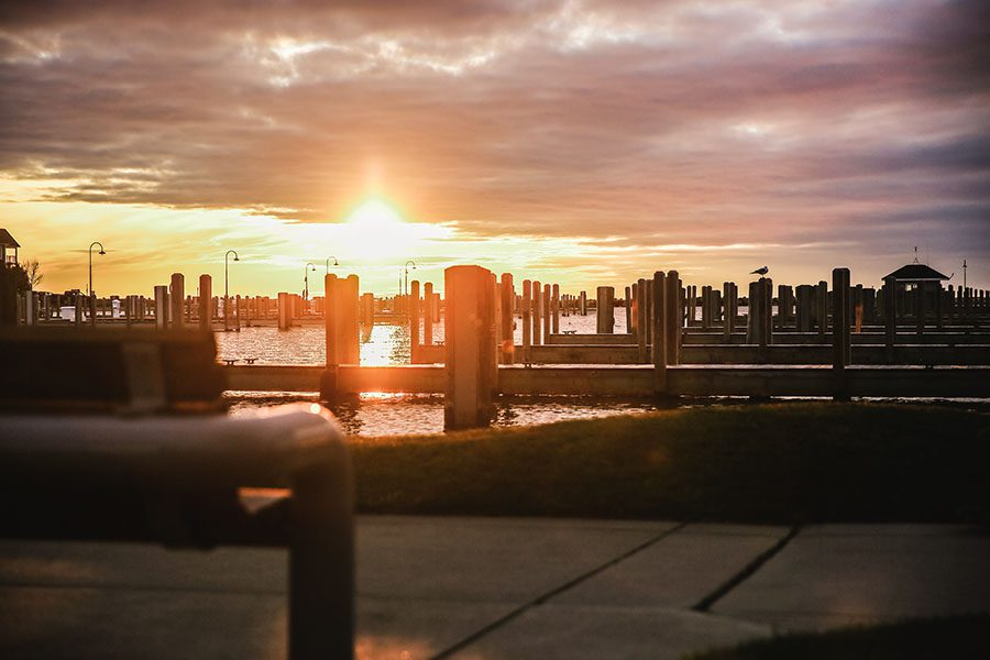Employee Benefits - Scenic View of Empty Wooden Docks on the Marina at Sunset with a Colorful Cloudy Sky