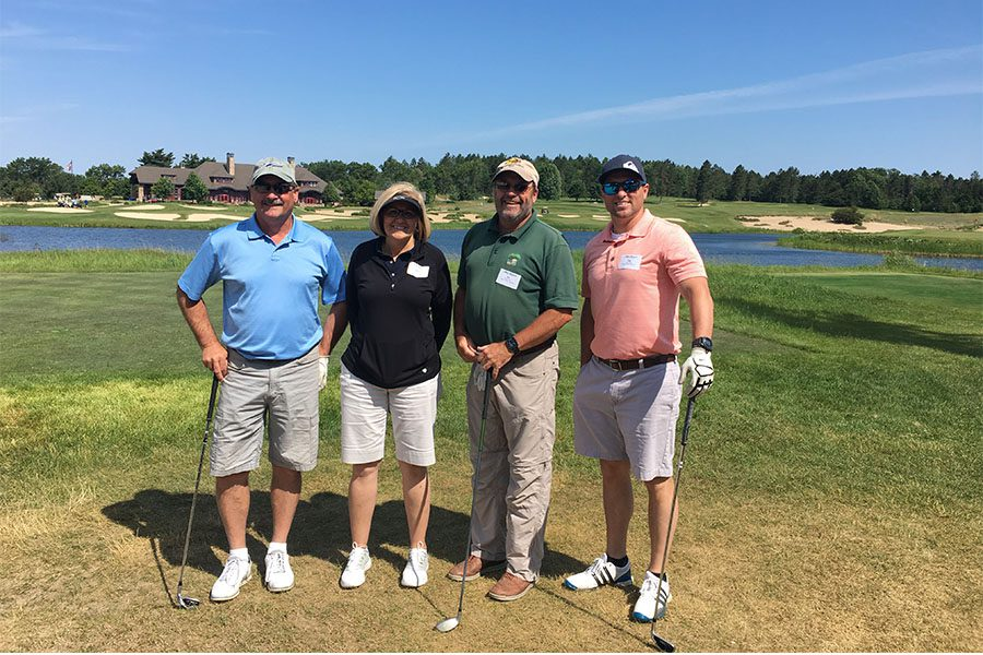 Our Culture - Harbor Brenn Insurance Employees Enjoying Golf on a Sunny Day