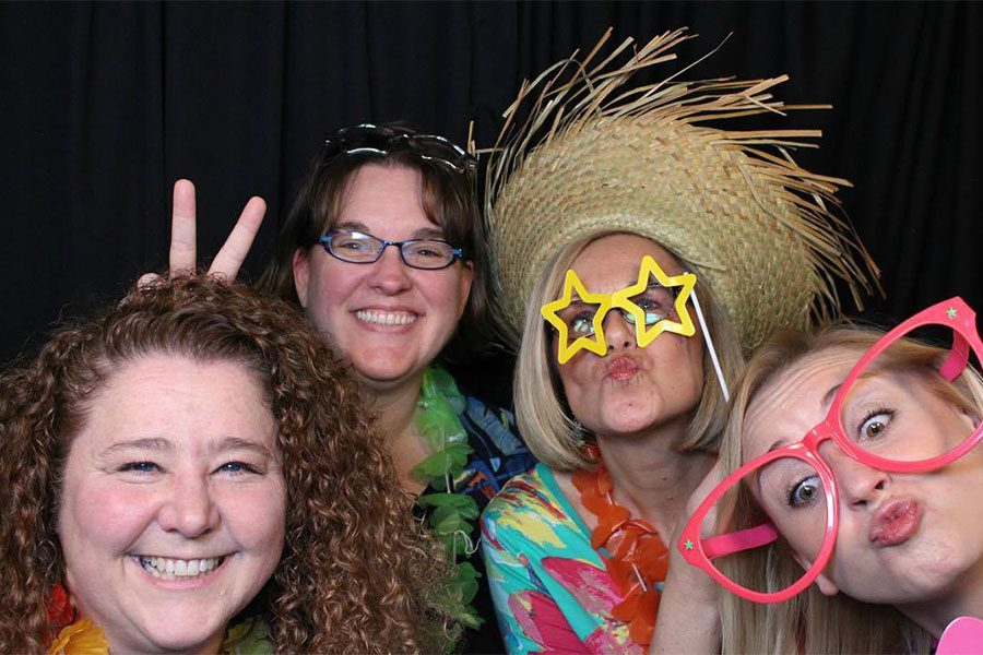 Our Culture - Harbor Brenn Insurance Staff Fun Picture with Hawaiian Shirts and Silly Glasses
