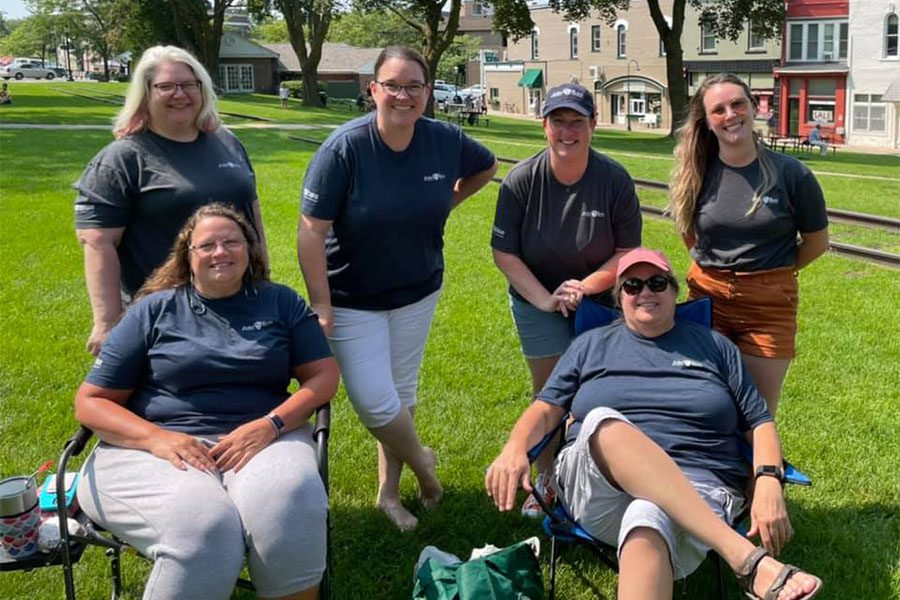 Our Culture - Portrait of Harbor Brenn Insurance Staff Relaxing at the Park