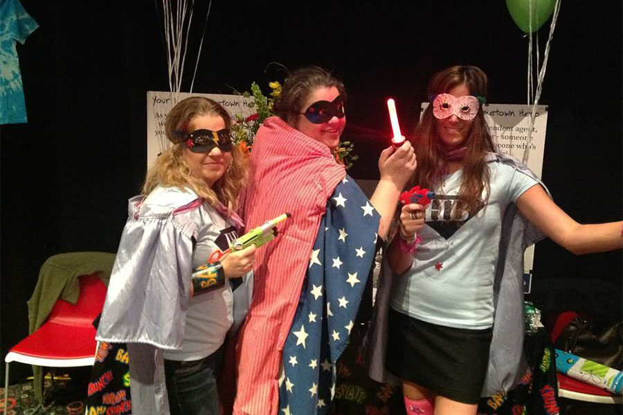 Our Culture - Three Harbor Brenn Insurance Employees Wearing Super Hero Capes and Costumes at Hometown Heroes Event
