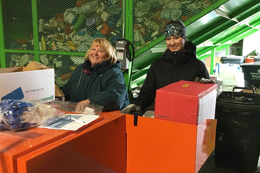 Our Culture - Two Smiling Harbor Brenn Insurance Employees at Recycling Facility