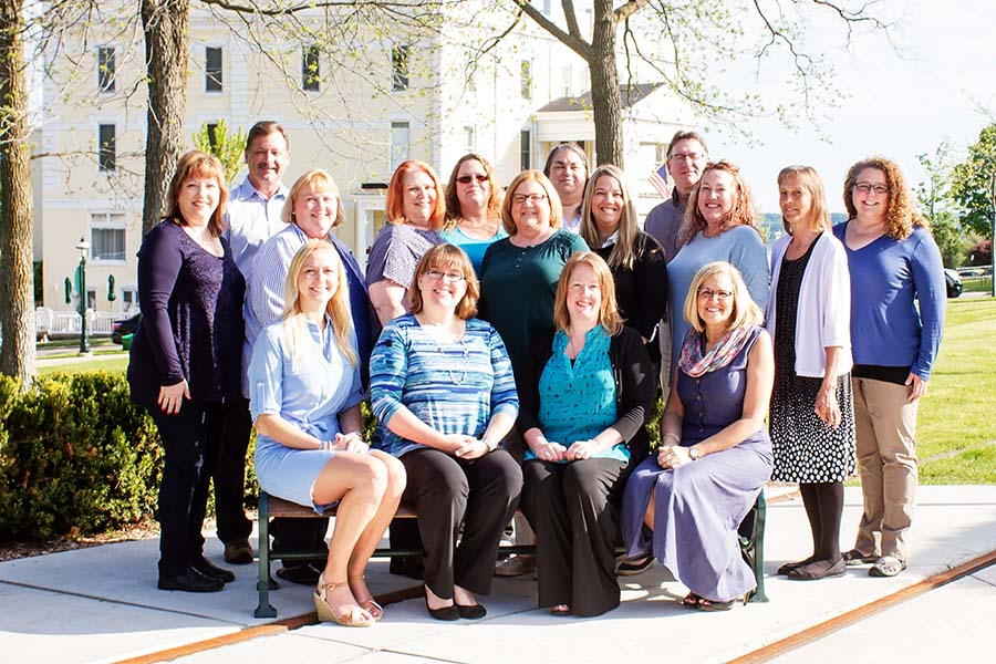 Personal Insurance - Portrait of the Harbor Brenn Insurance Agencies Staff Outside in a Park on a Sunny Day