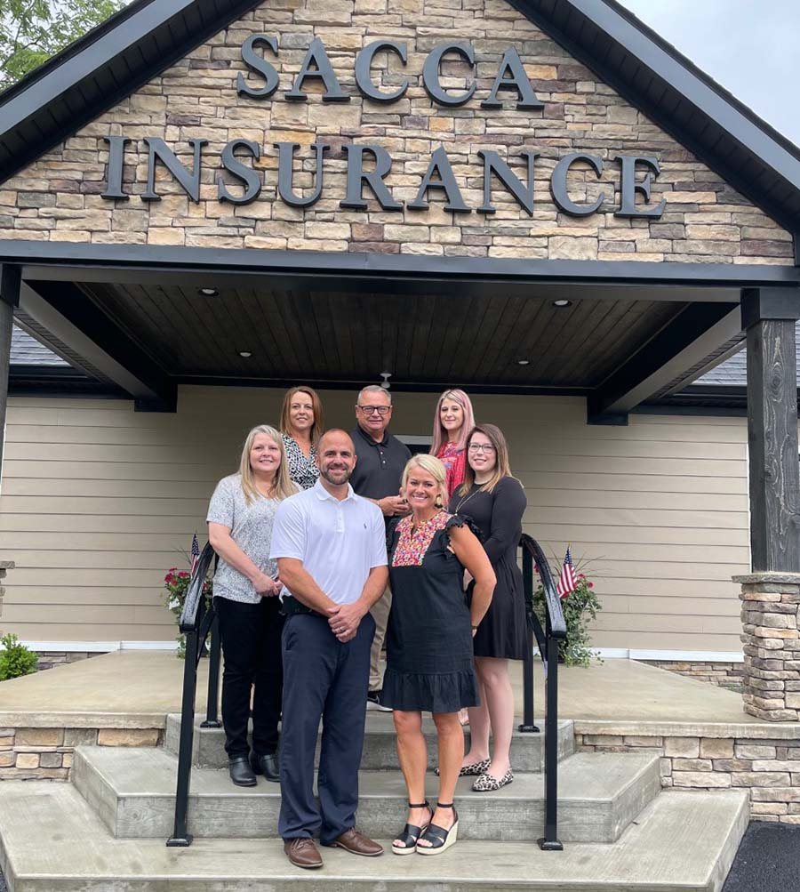 Meet Our Team - Sacca Insurance Staff Standing Together Outside Their Office Building
