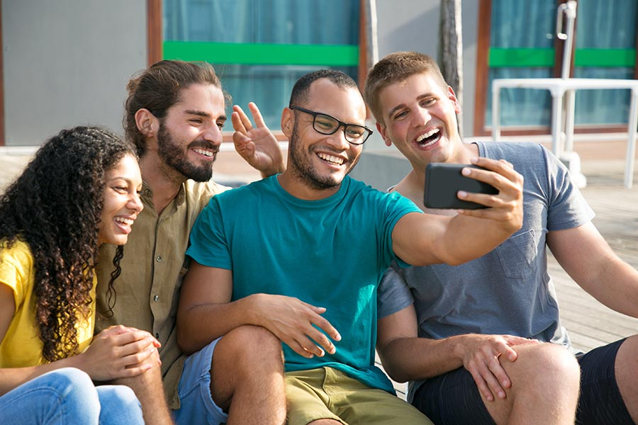 Employee Benefits - Group of Coworkers Laughing and Taking a Break Outside, Taking a Selfie Together