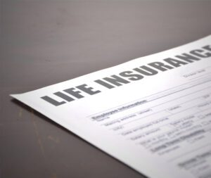 paper that says 'life insurance' at the top