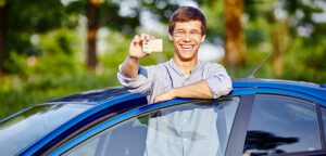 teenager showing off his new license