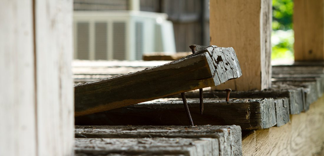 a loose board on a deck