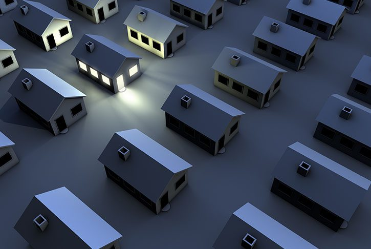 3D Rendered homes, one has lights on