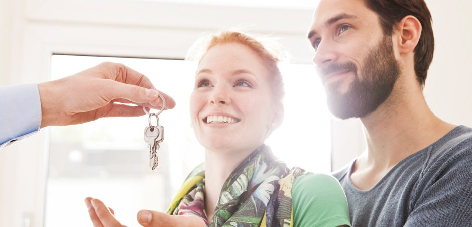 a couple being handed keys