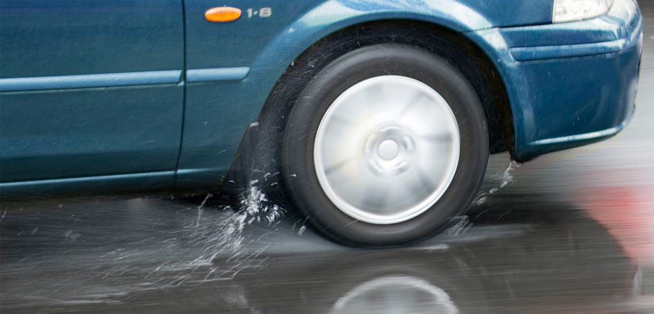 car driving on wet road