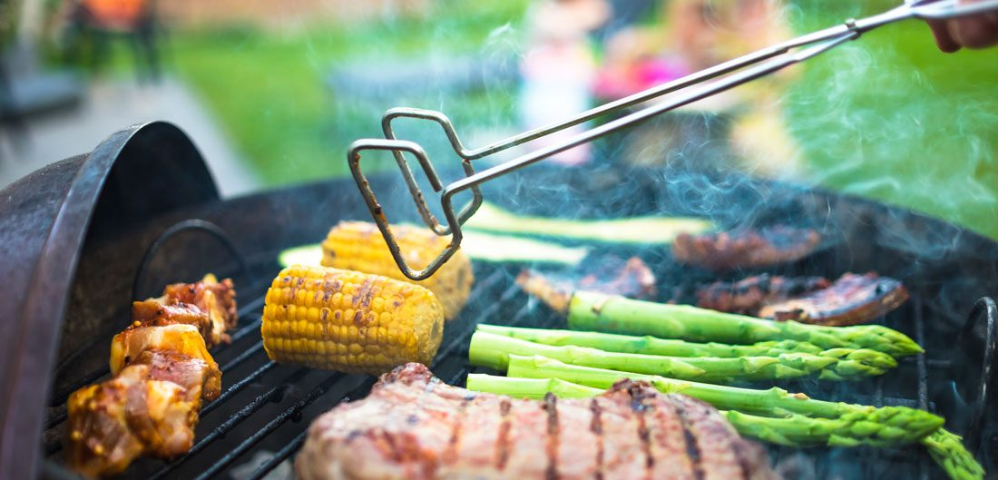 vegetables and meat cooks on grill