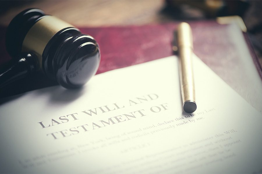 Fiduciary Bonds - Closeup View of a Last Will and Testament Document with a Pen and a Gavel on Top