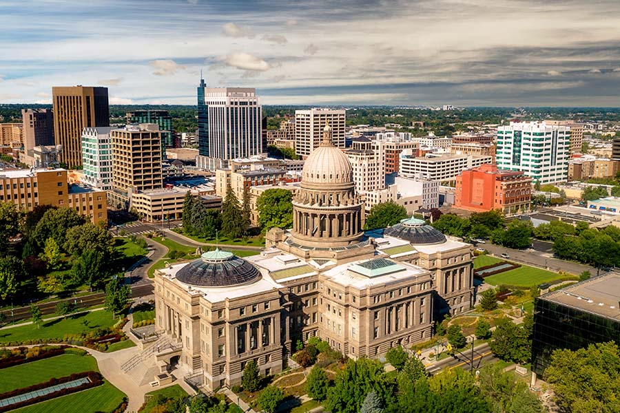 Contact - Aerial View of Boise Idaho Skylin Displaying the Capital Building and Many Other Business Buildings With Trees on a Semi Cloudy Day