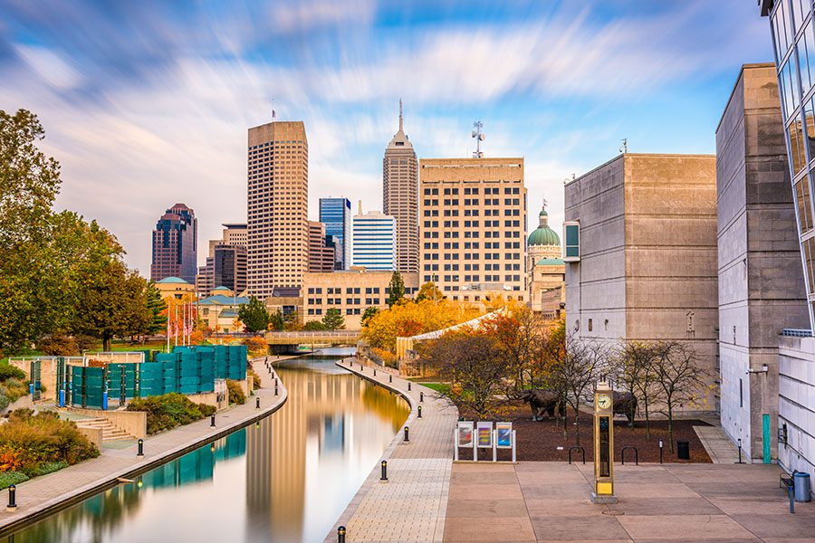 About Our Agency - Medium Distance View of Buildings and a River in Indianapolis, IN on a Bright Day