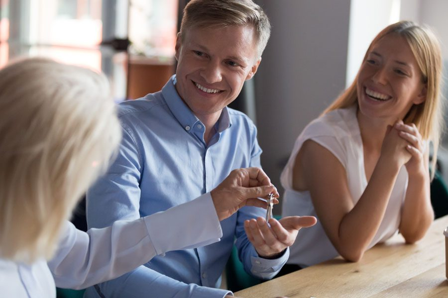 Property Manager Insurance - Family Getting Keys from the Property Management Company