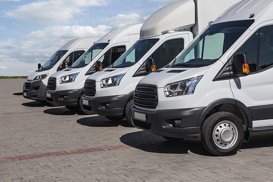 Specialized Business Insurance - Fleet of White Vans Parked in a Row
