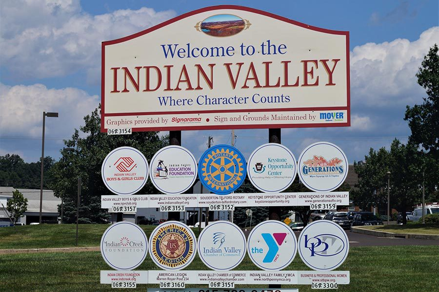 Harleysville, PA Insurance - Sign for Indian Valley in Pennsylvania, Ball Fields and a Bright Blue Sky Behind