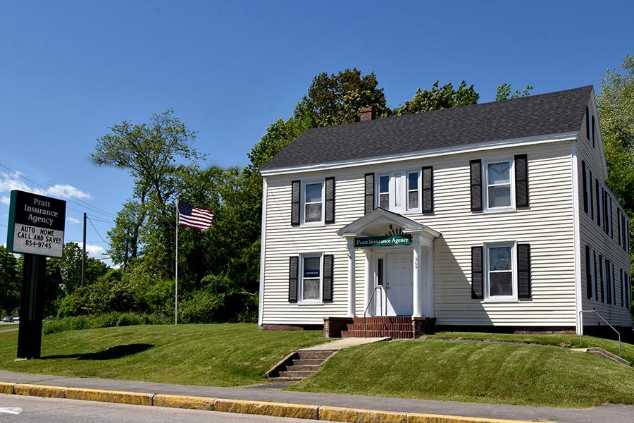 Contact - Office Location of Pratt Insurance Agency in Westbrook, Maine, a White Building with Black Shutters