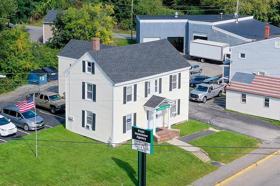 Westbrook, ME Insurance - Aerial View of Pratt Insurance Agency's White Sided Office with Black Shutters, in Westbrook, Maine