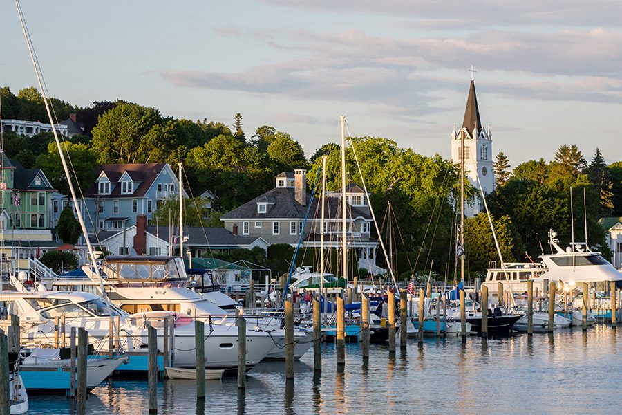 About Our Agency - View Of Dock and Boats in a Harbor in Lake Michigan at Dusk