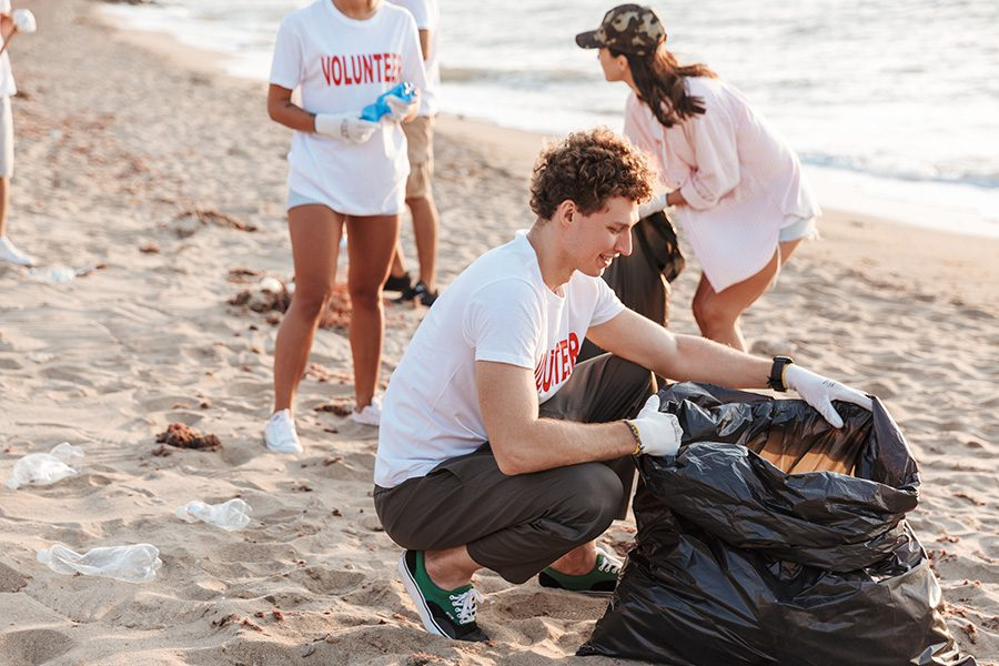 Specialized Business Insurance - A Group of Teenage Volunteers Cleaning a Beach From Plastic With Trash Bags