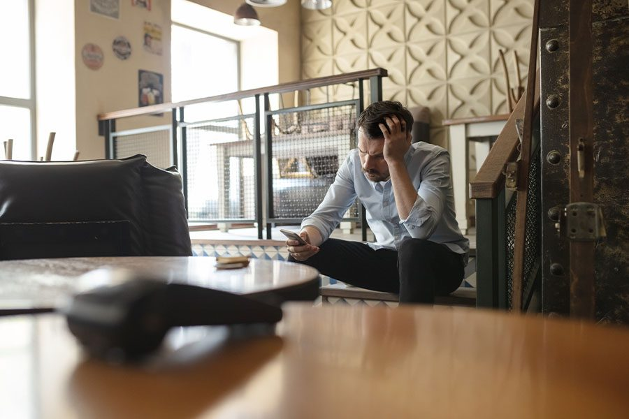 Business Interruption Insurance - Restaurant Bar Closed Due to Unforeseen Events with View of a Small Business Owner Stressed over His Finance Crisis