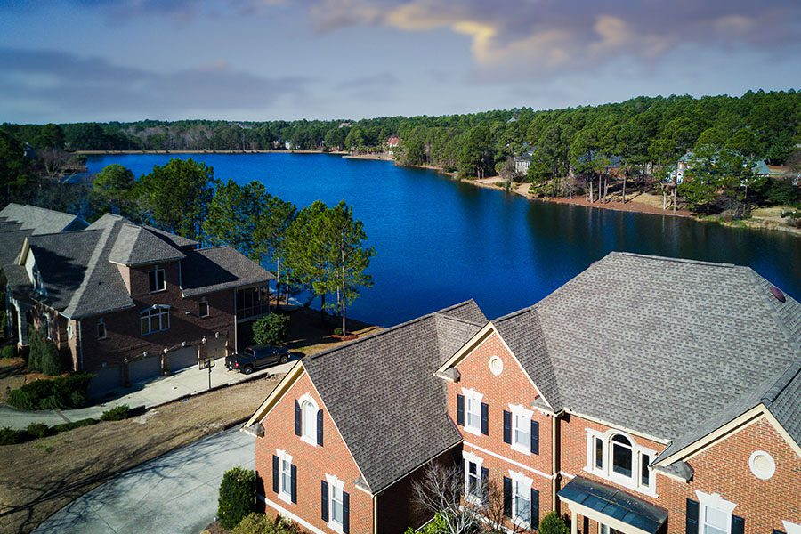 Anderson, SC - Aerial View of Two Large South Carolina Homes Near a Large Lake on a Semi Cloudy Day