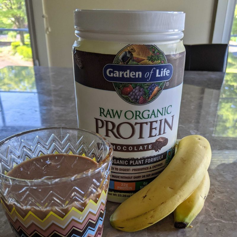 Favorite Beverage - 2 Bananas, Glass With Chocolate Protein Drink, Container of Protein Powder