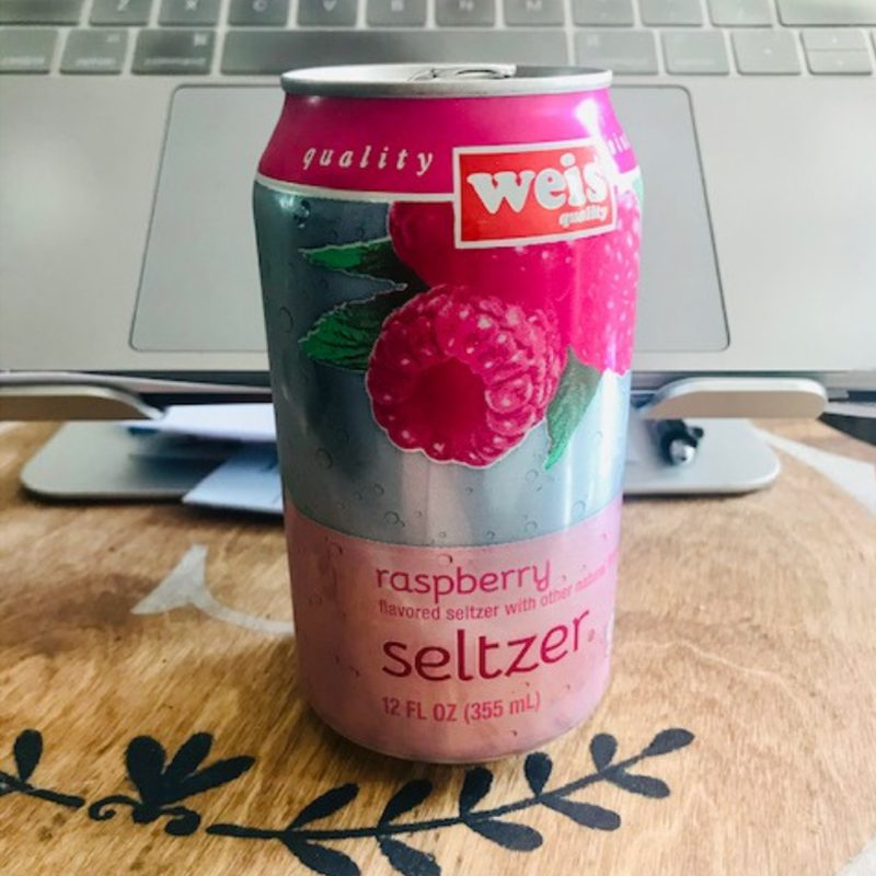 Favorite Beverage - Can of Raspberry Seltzer in Front of Laptop