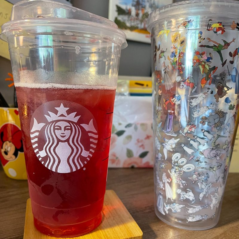 Favorite Beverage - Large Starbucks Cup With Red Liquid and Tumbler With Disney Characters